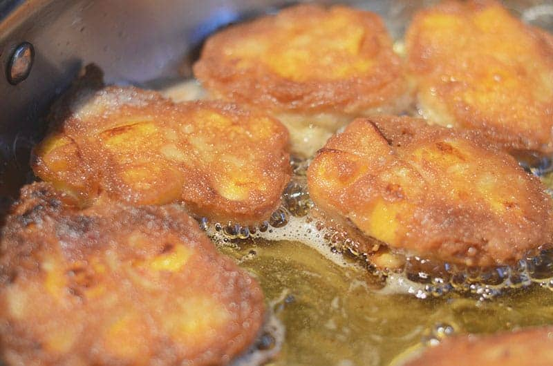 Peach fritters frying