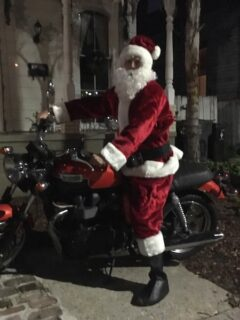man in santa suit on a motorcycle