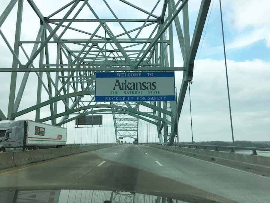Welcome to Arkansas sign on bridge