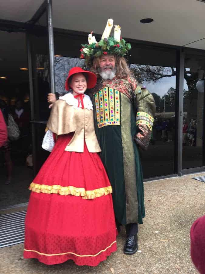 Man and woman in Christmas Carol costumes