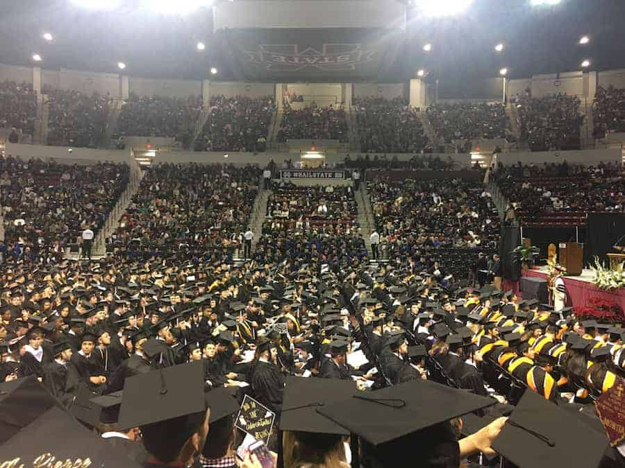 MSU graduation ceremony in stadium with tops of graduation hats in view