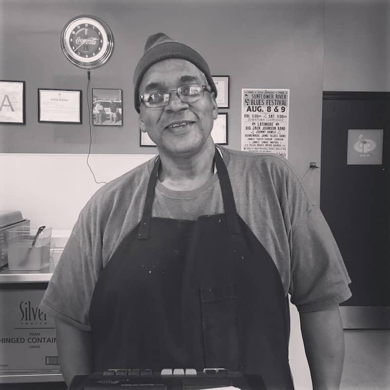 Man behind cash register at tamale shop