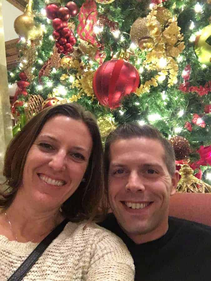 Man and woman in front of Christmas Tree