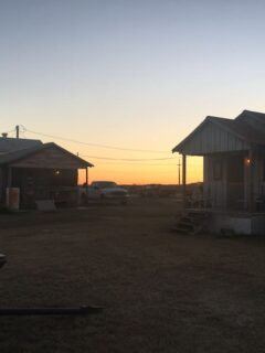 sunrise over 2 cabins in MS