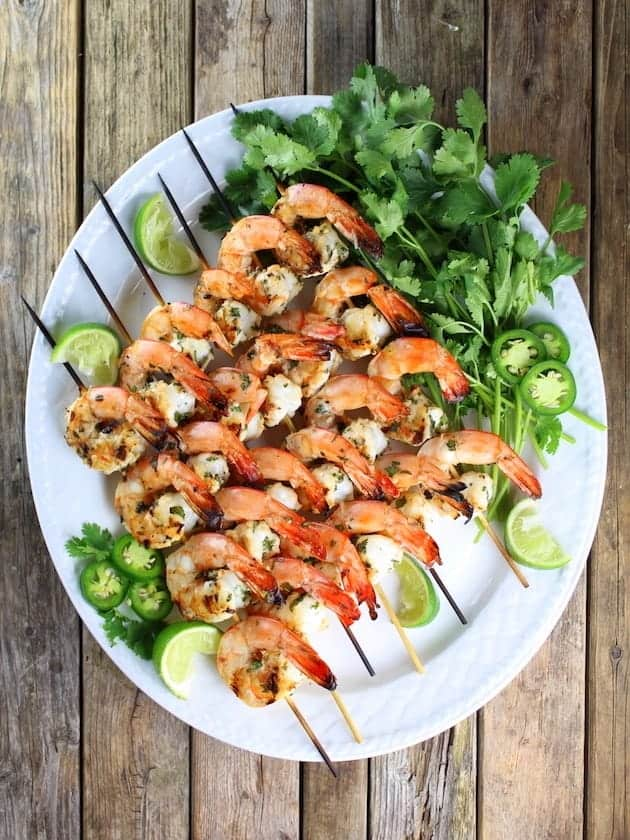 overhead view of platter with skewers of grilled shrimp