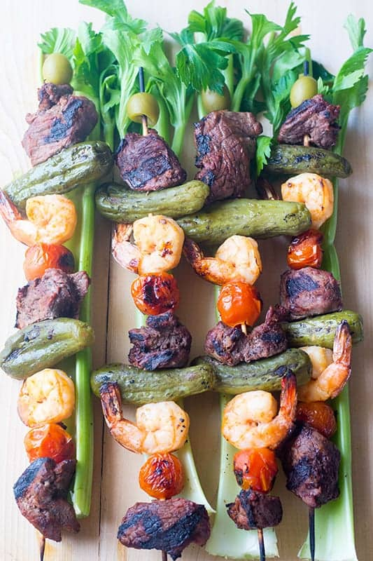 overhead view of steak kabobs with celery