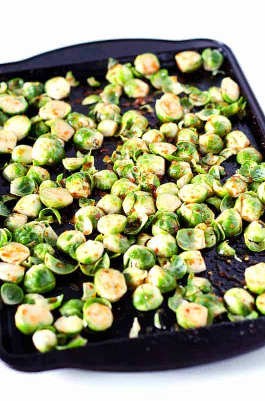 spicy brussel sprouts on pan before cooking