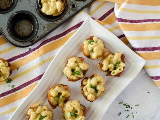 overhead view of a plate of mini prosciutto cups filled with mac and cheese