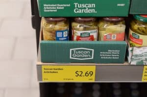 jars of artichokes on shelf at Aldi