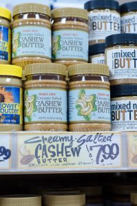 jars of cashew butter on shelf
