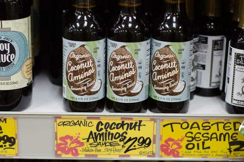 bottles of organic coconut aminos on shelf
