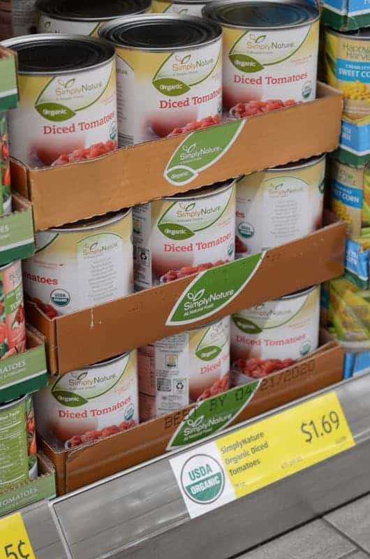 cans of diced tomatoes on shelf at Aldi