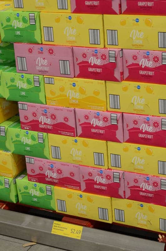 stacked cases of flavored seltzer at Aldi