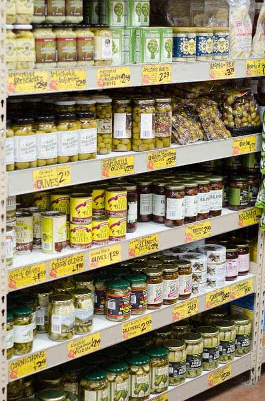 shelf of olives and pickles in grocery store