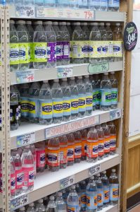 shelf of seltzer water bottles