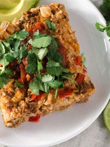 overhead view of beef taco casserole on plate with cilantro garnish