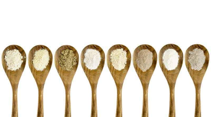 wooden spoons with variety of all purpose flour substitutes in them