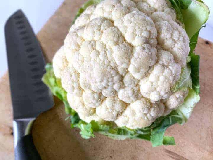 head of cauliflower on a cutting board