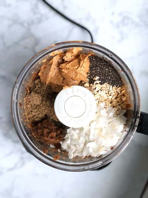 overhead view of food processor with ingredients for energy balls