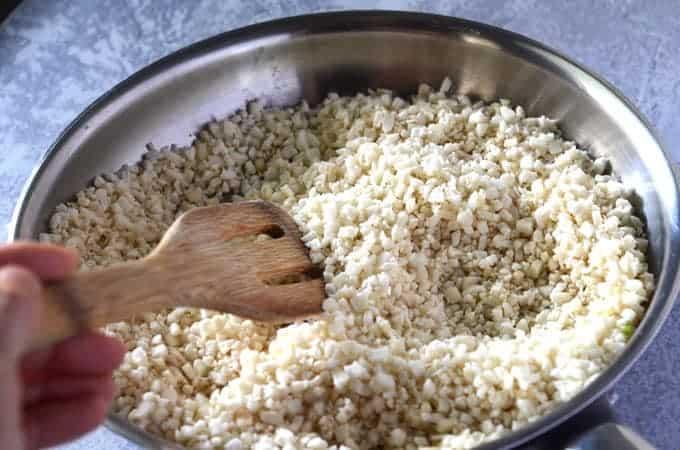 Cauliflower rice cooking in pan