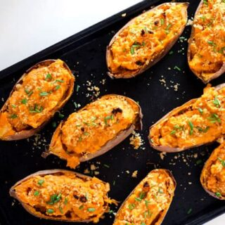 overhead view of baking sheet with twice baked sweet potatoes