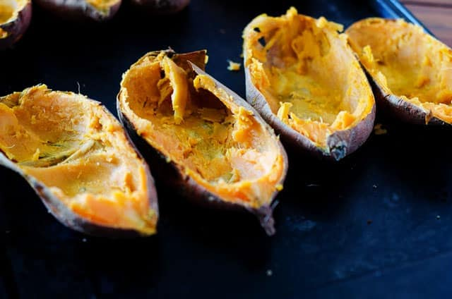 baking sheet with sweet potato skins and insides scooped out