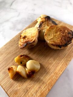 head of roasted garlic on cutting board