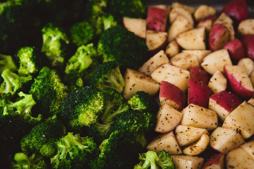 Close up image of broccoli and roasted potatoes