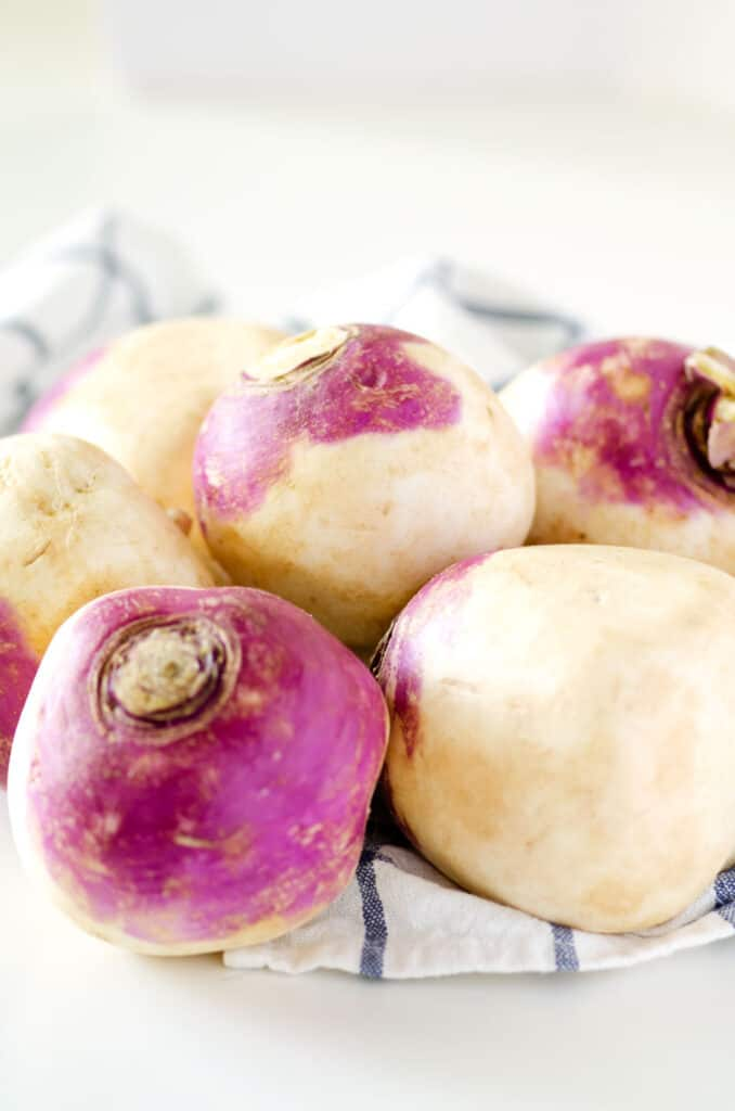 close up of raw turnips on a countertop