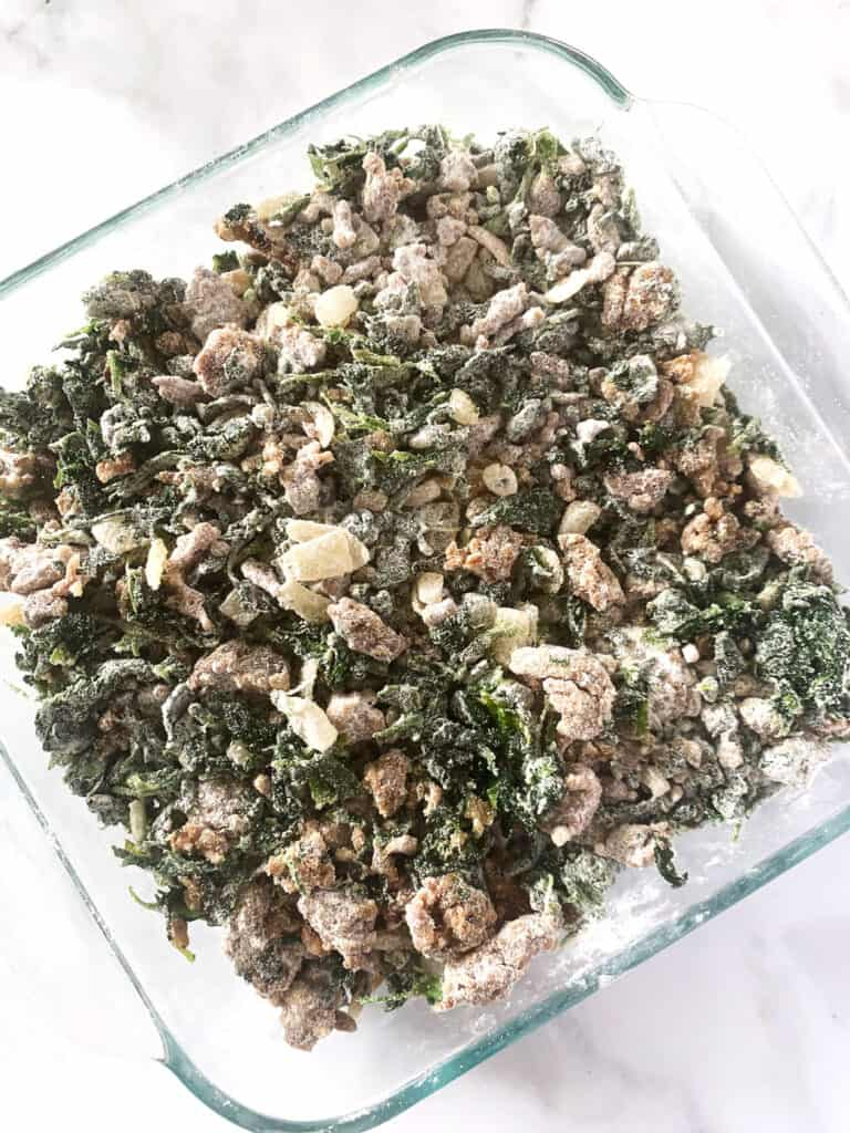 Overhead view of spinach egg casserole coated with flour