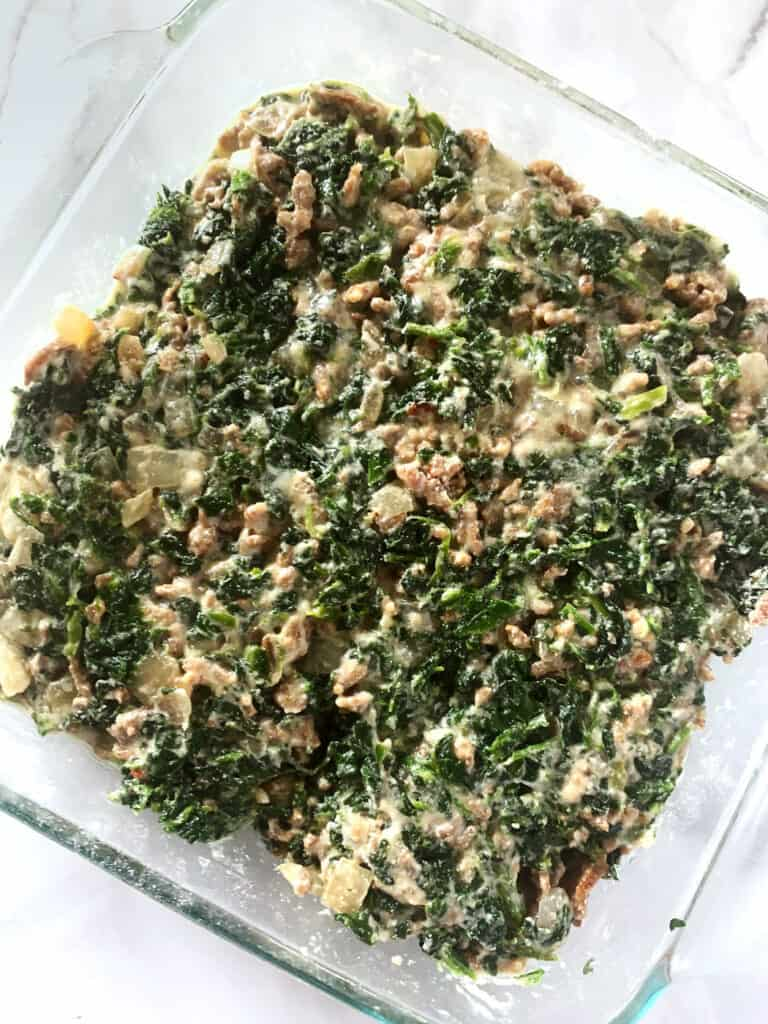 Overhead view of spinach egg casserole before baking