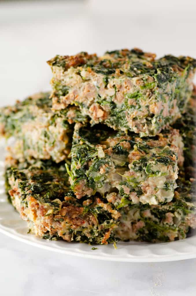 squares of spinach egg casserole stacked on a plate