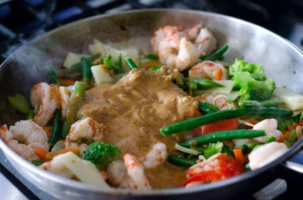 shrimp stir fry with sauce in a pan