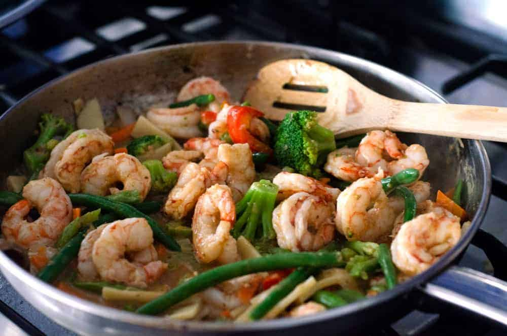 paleo shrimp stir fry in a pan on the stove