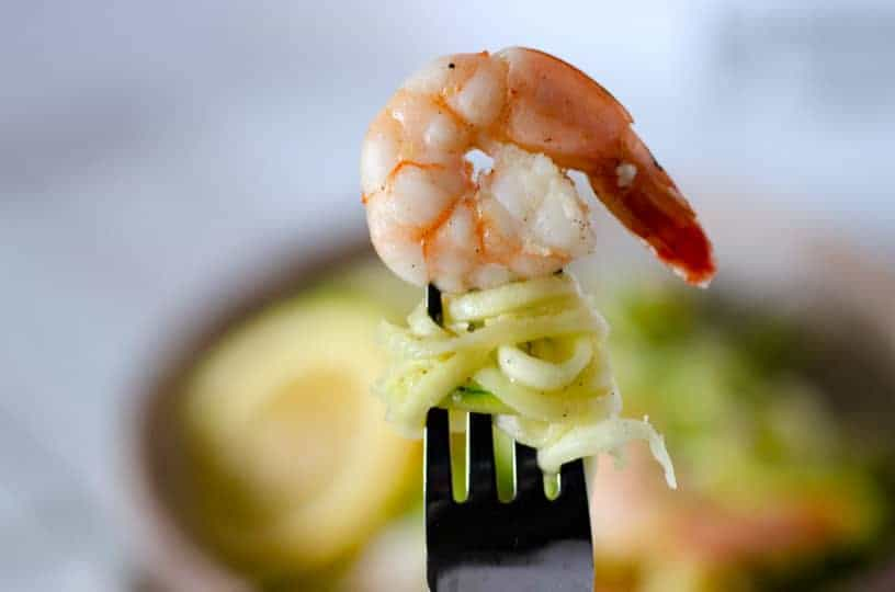 Close up of fork with zoodles and a shrimp