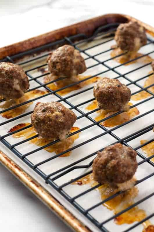 cooked paleo meatballs on a baking sheet