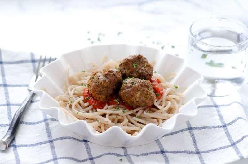 white wavy bowl with cassava spaghetti and paleo meatballs