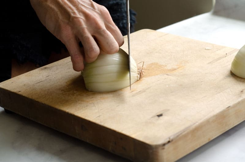 half an onion with knuckles back trimming root ball