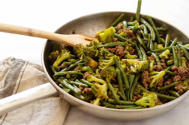 Ground beef and green beans in a skillet